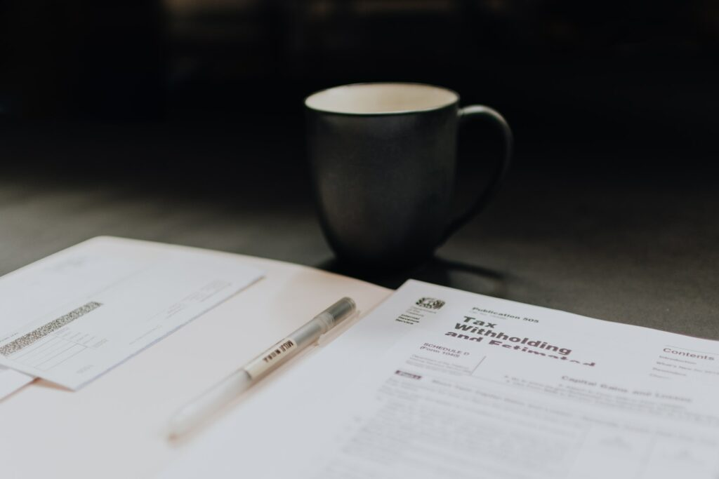 A cup of coffee and papers